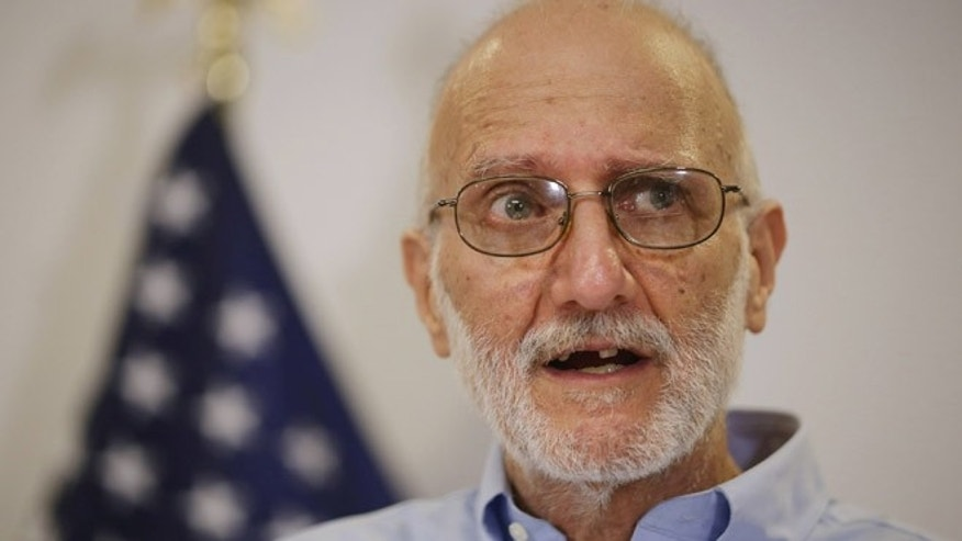 WASHINGTON, DC - DECEMBER 17:  Alan Gross makes a statement to the news media at the law offices of Gilbert LLC after arriving back in the United States December 17, 2014 in Washington, DC. A United States Agency for International Develpment contractor, Gross was imprisoned in Cuba for five years on espionage charges after he delivered satellite telephone equipment to Jews living on the island. Gross' release is signalling a new era in U.S.-Cuba relations as President Barack Obama announced a political thawing between the two countries, the first in more than 50 years.  (Photo by Chip Somodevilla/Getty Images)