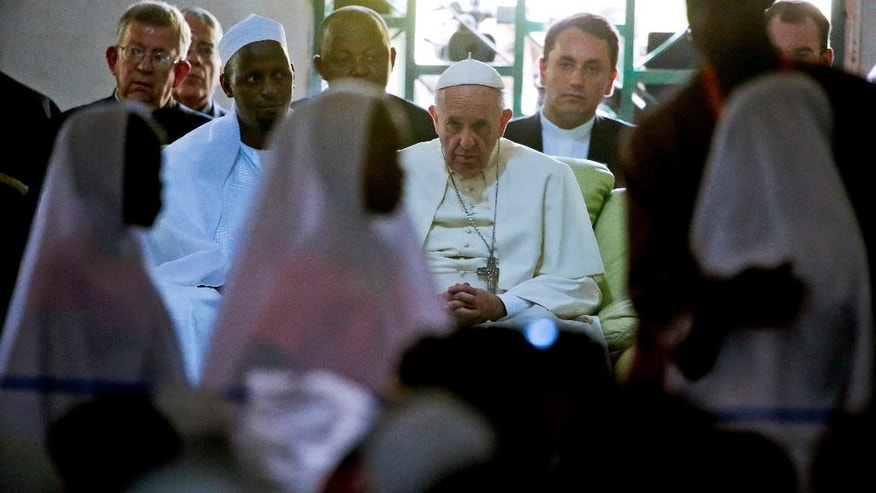 Pope Francis, flanked by the Imam Tidjani of the Koudoukou mosque, meets with the Muslim community at the Koudoukou mosque on the occasion of his visit, in Bangui, Central African Republic, Monday, Nov. 30, 2015. (AP Photo/Andrew Medichini)