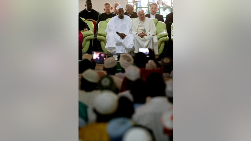 Pope Francis, flanked by the Imam Tidjani of the Koudoukou mosque, meets with the Muslim community at the Koudoukou mosque, in Bangui, Central African Republic, Monday, Nov. 30, 2015. Pope Francis is in Africa for a six-day visit that is taking him to Kenya, Uganda and the Central African Republic. (AP Photo/Andrew Medichini)