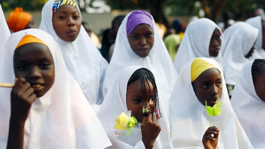 Children wait for the arrival of Pope Francis on the occasion of his visit at the Central Mosque in Bangui's Muslim enclave of PK5, Central African Republic, Monday Nov. 30, 2015. The Pope was welcomed by a crowd of people and prayed inside the Central Mosque. (AP Photo/Jerome Delay)