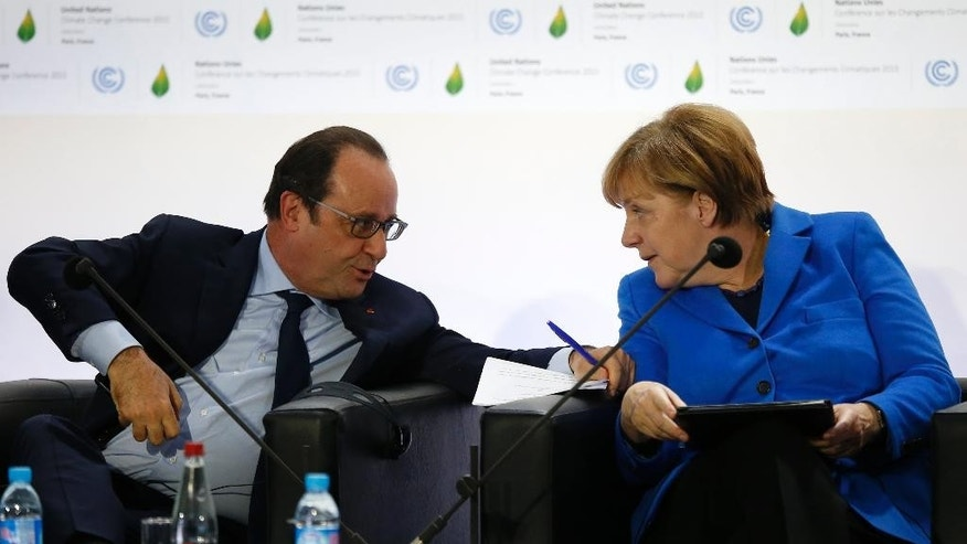 French President Francois Hollande and German Chancellor Angela Merkel attend the Carbon Price conference at the COP21, United Nations Climate Change Conference, in Le Bourget, outside Paris, Monday, Nov. 30, 2015.  (AP Photo/Francois Mori)
