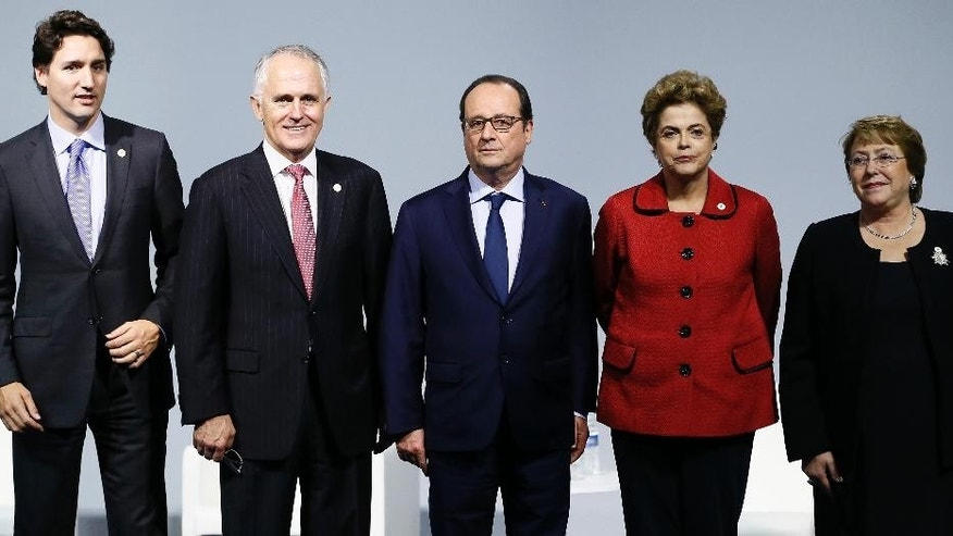 From the left, Canadian Prime Minister Justin Trudeau, Australian Prime Minister Malcolm Turnbull, French President Francois Hollande, Brazilian President Dilma Roussef, and Chilean President Michelle Bachelet attend the 'Mission Innovation: Accelerating the Clean Energy Revolution' meeting at the COP2, United Nations Climate Change Conference, in Le Bourget, north of Paris, Monday, Nov. 30 2015. (Ian Langsdon, Pool photo via AP)