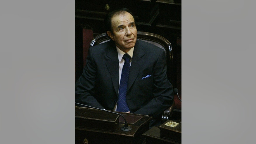 FILE - In this Nov. 29, 2005 file photo, Argentina's former President Carlos Menem attends his swearing-in ceremony as senator for La Rioja province at the National Congress in Buenos Aires, Argentina. The Argentina official judicial news agency announced Tuesday, Dec. 1, 2015, that a local court sentenced the former president to four and half years in prison for embezzlement. . The 85-year-old was absent from the proceedings citing health problems. (AP Photo/Natacha Pisarenko, File)