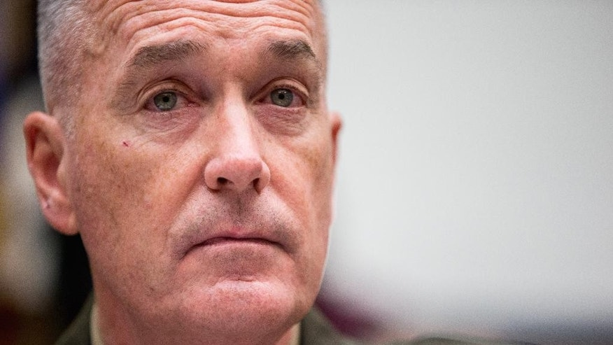Joint Chiefs Chairman Gen. Joseph Dunford Jr. testifies on Capitol Hill in Washington, Tuesday, Dec. 1, 2015, before the House Armed Services Committee hearing on the U.S. Strategy for Syria and Iraq and its Implications for the Region. (AP Photo/Andrew Harnik)
