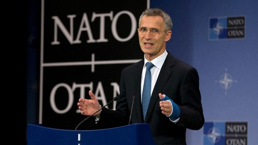 NATO Secretary General Jens Stoltenberg speaks during a media conference at NATO headquarters in Brussels on Tuesday, Dec. 1, 2015. U.S. Secretary of State John Kerry and other NATO foreign ministers met Tuesday to discuss Russia, beefing up the alliance's southern defenses and whether to expand NATO by adding Montenegro to the NATO Alliance. (AP Photo/Virginia Mayo)