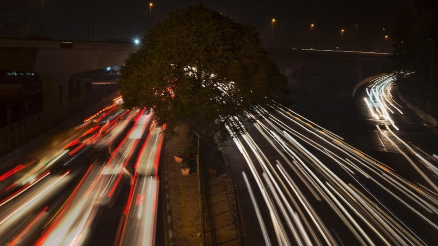 In this Dec 1, 2015 photo, streaks of light show traffic moving in New Delhi, India. Over the last decade the city's air pollution has grown so rapidly that the cold weather turns the city into a grey, smog-filled health nightmare. New Delhi has earned the dubious distinction of being the world's dirtiest city, surpassing Beijing, once the poster child for air pollution. (AP Photo /Tsering Topgyal)