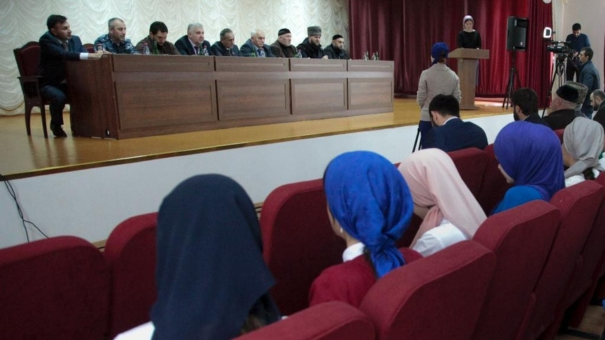 In this photo taken on Thursday, Oct.  29, 2015, local students listen to Islamic clerics and government officials during a lecture of counter IS propaganda in Grozny, the capital of Chechnya, Southern Russia. Authorities in Russia's predominantly Muslim republic of Chechnya are holding classes to stave off Islamic State recruitment. (AP Photo/Musa Sadulayev)