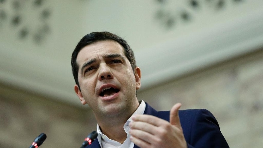 Greece's Prime Minister Alexis Tsipras speaks to the lawmakers of his Syriza party at the parliament in Athens, Tuesday, Dec. 1, 2015. Greece's European creditors have said they will consider some form of debt relief for Greece after they complete a first review of reforms the country must take under its new three-year bailout, an 86 billion euro package agreed on in July with the coalition government of Prime Minister Alexis Tsipras. (AP Photo/Thanassis Stavrakis)