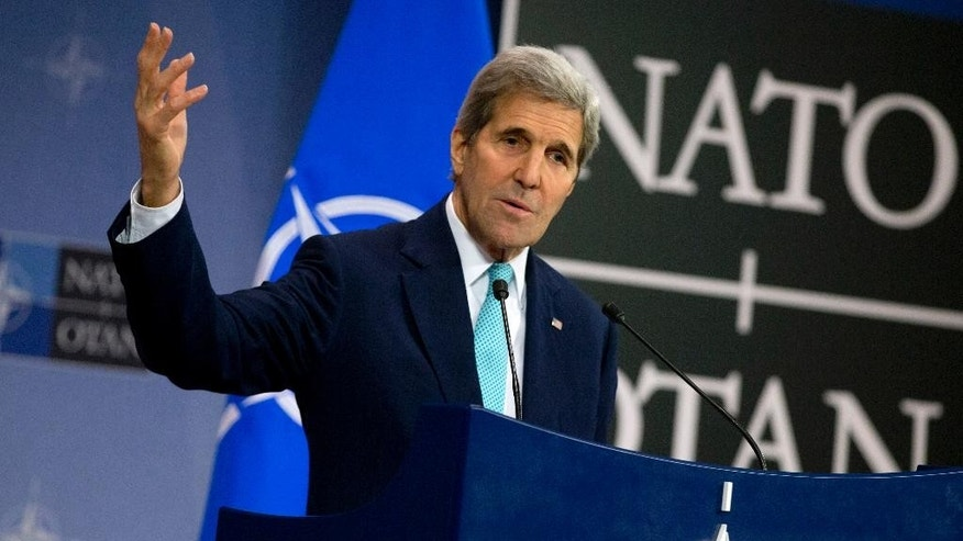 U.S. Secretary of State John Kerry speaks during a media conference at NATO headquarters in Brussels on Wednesday, Dec. 2, 2015. U.S. Secretary of State John Kerry says NATO members stand ready to step up military efforts against the Islamic State. (AP Photo/Virginia Mayo)