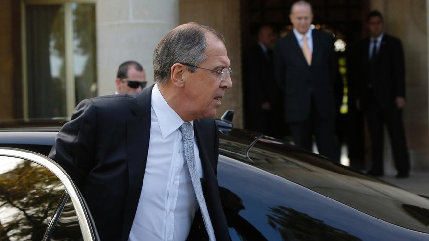 Russian Foreign Minister Sergey Lavrov arrives at the presidential palace for talks with Cyprus' President Nicos Anastasiades in Nicosia, Wednesday, Dec. 2, 2015. (AP Photo/Petros Karadjias)