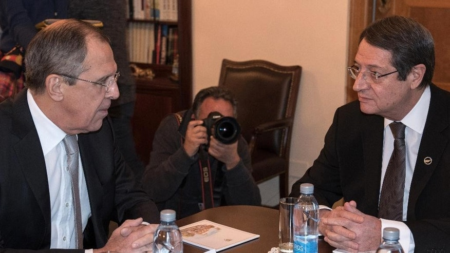 Russian Foreign Minister, Sergey Lavrov, left, and Cyprus' President, Nicos Anastasiades, talk during their meeting at the presidential palace in Nicosia, Wednesday, Dec. 2,  2015. Lavrov is in Cyprus for a 24-hour official visit. (Iacovos Hadjistavrou/Pool Photo via AP)
