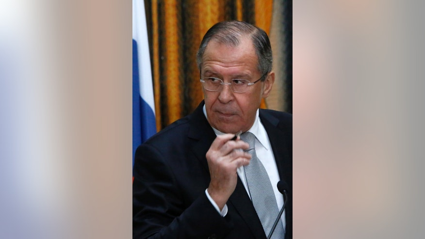 Russian Foreign Minister, Sergey Lavrov, listens during a press conference after talks with his Cypriot counterpart, Ioannis Kasoulides, at the foreign ministry house in Nicosia, Wednesday, Dec. 2,  2015. Lavrov says he won't refuse a meeting with his Turkish counterpart in Serbia's capital this week to hear Turkey's explanations on the downing of a Russian air force jet. Lavrov is in Cyprus for a 24-hour official visit. (AP Photo/Petros Karadjias)