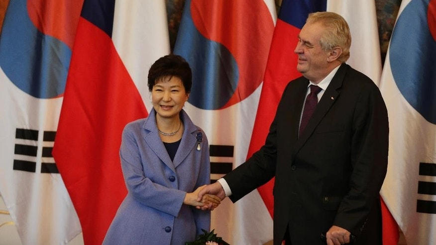Czech Republic's President Milos Zeman, right, welcomes his South Korean counterpart Park Geun-hye, left, at the Prague castle during her working visit in Prague, Czech Republic, Wednesday, Dec. 2, 2015. (AP Photo/Petr David Josek)
