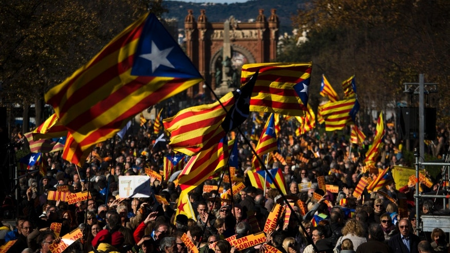 "FILE - In this Nov. 22, 2015 file photo, pro Independence demonstrators wave ""esteladas"" or pro independence flags, during a demonstrations to show public support for the Parliament of Catalonia, in Barcelona, Spain. Spain's Constitutional Court has rejected a Catalan regional parliament resolution setting a road map for independence from Spain by 2017. In a sentence published Wed. Nov. 2, 2015, the court said the resolution adopted Nov. 9 by the Barcelona-based parliament violated five articles of the country's 1978 constitution and articles of the region's own statute. (AP Photo/Emilio Morenatti, File)"