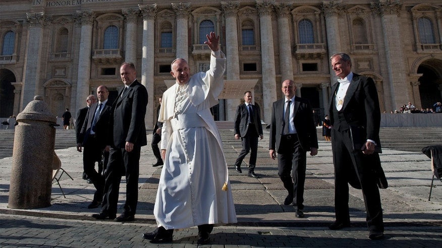 Pope Francis waves as he leaves at the end of his general audience in St. Peter's Square at the Vatican, Wednesday, Dec. 2, 2015. (AP Photo/Alessandra Tarantino)