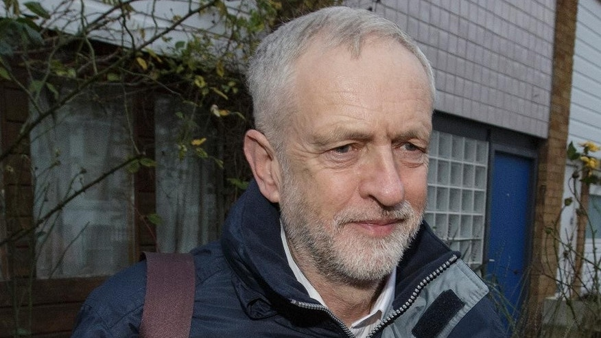 Britain's Labour Party leader Jeremy Corbyn leaves his home in London to attend a debate in Parliament before members of Parliament vote on whether to back  air strikes in Syria, Wednesday Dec. 2, 2015. (AP Photo/Tim Ireland)