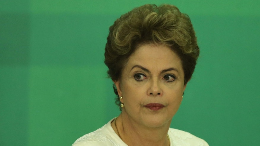 Dec. 2, 2015: Brazil's President Dilma Rousseff arrives at a press conference after impeachment proceedings were opened against her by the President of Chamber of Deputies Eduardo Cunha, at the Planalto Presidential Palace in Brasilia, Brazil.
