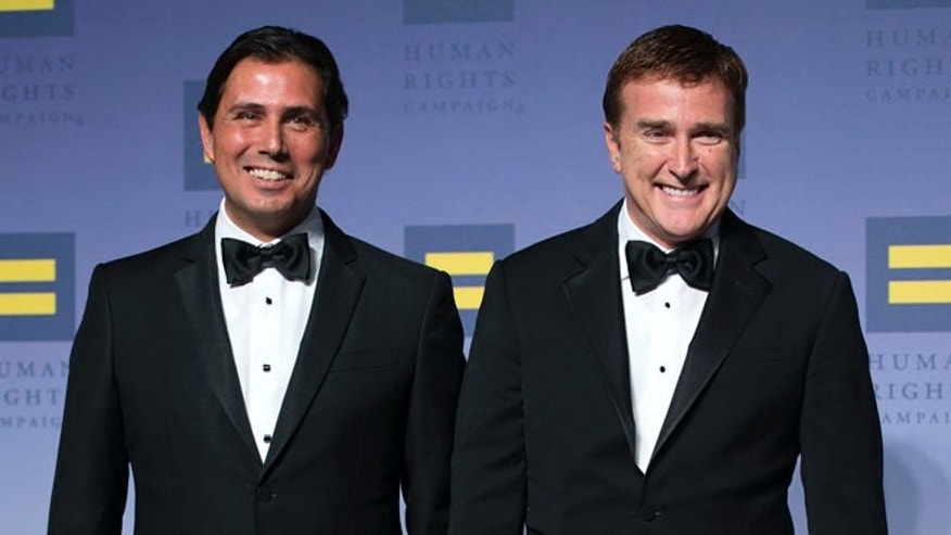 United States Ambassador to the Dominican Republic James 'Wally' Brewster and husband Bob Satawake attend the 19th Annual HRC National Dinner at Walter E. Washington Convention Center on October 3, 2015, in Washington, D.C. (Photo by Leigh Vogel/Getty Images)