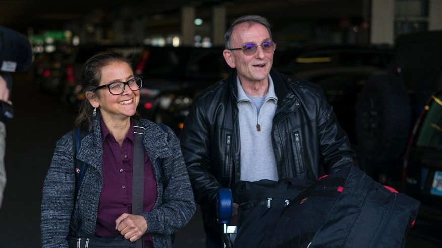 "Lori Berenson, who completed a 20-year sentence in Peru for ""collaboration with terrorism"" in aiding the Tupac Amaru Revolutionary Movement, walks with her uncle Ken Berenson after arriving at John F. Kennedy International Airport in New York, Thursday, Dec. 3, 2015. Berenson, who traveled to Peru two decades ago bent on revolutionary change, returned to her native New York City upon completion of her sentence.  (AP Photo/Craig Ruttle)"