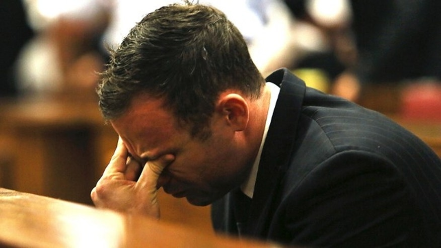 FILE - In this Friday, Sept. 12, 2015 file photo, Oscar Pistorius puts his hand on his face in court in Pretoria, South Africa, as judgement is passed in the shooting death of his girlfriend, Reeva Steenkamp. (AP Photo/Alon Skuy, Pool, File)