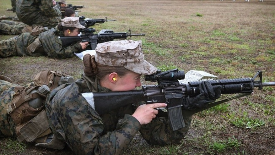 PARRIS ISLAND, SC - FEBRUARY 25:  Female Marine recruits fire on the rifle range during boot camp February 25, 2013 at MCRD Parris Island, South Carolina. All female enlisted Marines and male Marines who were living east of the Mississippi River when they were recruited attend boot camp at Parris Island. About six percent of enlisted Marines are female.  (Photo by Scott Olson/Getty Images)
