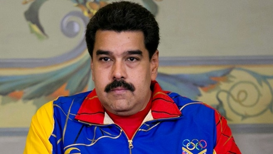 Venezuela's President Nicolas Maduro sits quietly during a ceremony for the athletes that will participate in the upcoming Toronto Pan American games, at Miraflores Presidential Palace in Caracas, Venezuela, Tuesday, June 16, 2015. President Maduro said on Monday night that a recent meeting between Venezuelan and U.S. officials has opened an important channel that could lead toward restoration of full diplomatic relations. (AP Photo/Ariana Cubillos)