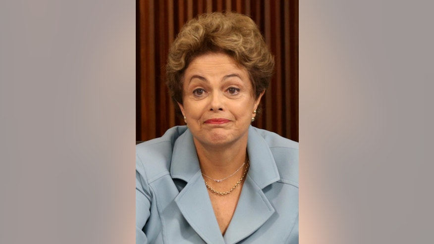 Brazil's President Dilma Rousseff gestures during a meeting with state governors regarding the impeachment process opened against her at Planalto presidential palace, in Brasilia, Brazil, Tuesday, Dec. 8, 2015. On Tuesday, parties are expected to nominate representatives for a special commission in the lower house to determine whether impeachment proceedings will go to a full vote in the house. The proceedings were introduced last week, citing a court's finding that Rousseff's administration violated fiscal responsibility laws by using money from state-run banks to fill budget gaps and pay for social programs. (AP Photo/Eraldo Peres)