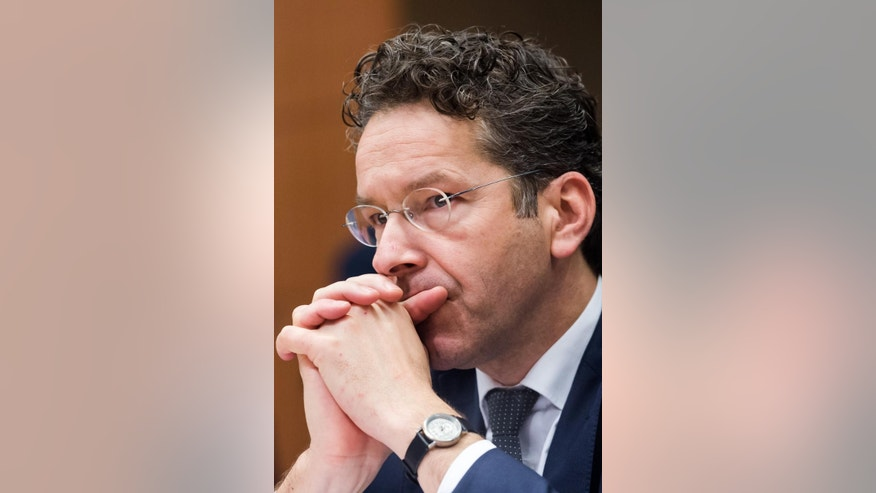 Dutch Finance Minister and chair of the eurogroup finance ministers Jeroen Dijsselbloem arrives for an Eurogroup finance ministers meeting at the EU Council building in Brussels on Monday, Dec. 7, 2015. (AP Photo/Geert Vanden Wijngaert)