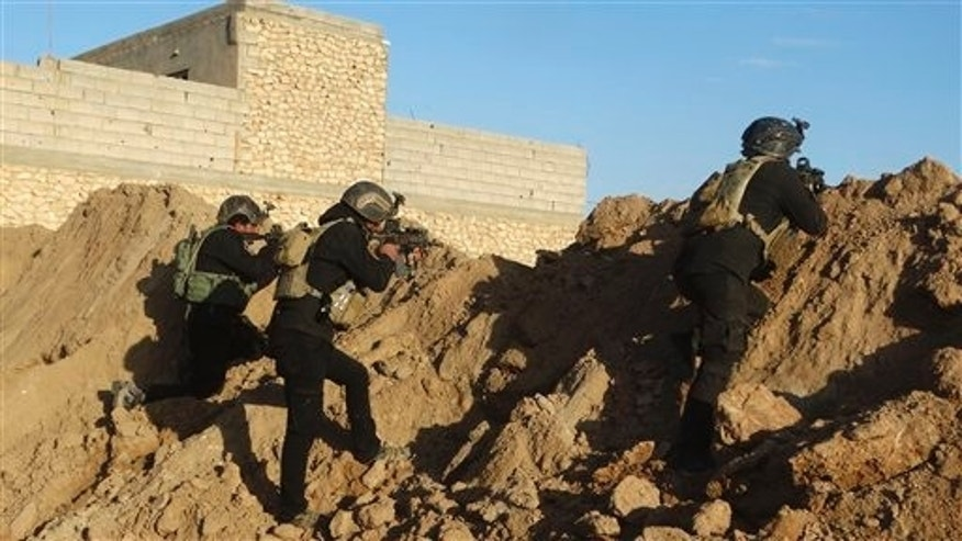 Iraqi security forces take combat position at the front-line with Islamic State militants near Ramadi.