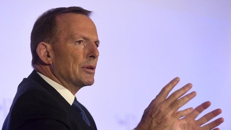 Former Australian Prime Minister Tony Abbott responds during a question and answer session after delivering a lecture at the Fullerton Hotel in Singapore on Wednesday, Dec. 9, 2015 (AP Photo/Joseph Nair)