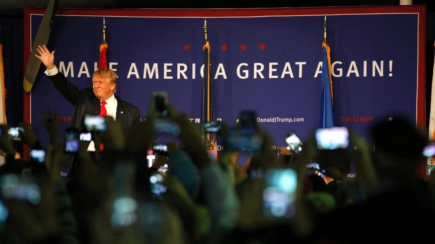 Republican presidential candidate, businessman Donald Trump, waves to supporters before his rally coinciding with Pearl Harbor Day at Patriots Point aboard the aircraft carrier USS Yorktown in Mt. Pleasant, S.C., Monday, Dec. 7, 2015. (AP Photo/Mic Smith)