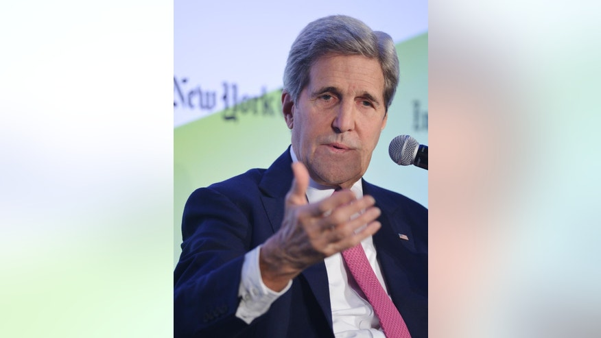 US Secretary of State John Kerry speaks during the International New York Times Energy for Tomorrow Conference at the Hotel Potocki in Paris, France, Dec. 9, 2015 on the sidelines of the COP21 United Nations conference on climate change. (AP Photo/Mandel Ngan, Pool via the AP)