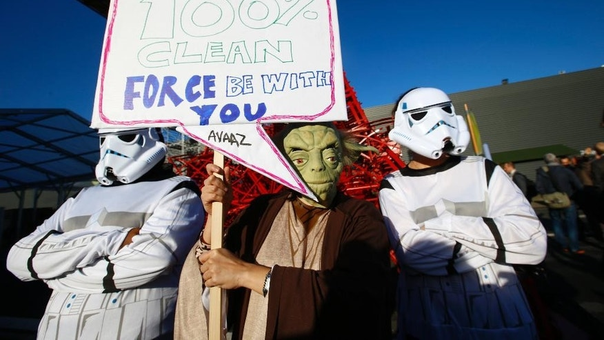 Global citizen's movement Avaaz in a Star Wars themed stunt with Yoda and two storm-troopers pose during a protest for Paris climate agreement to put the world on course for clean energy front of the mini red Eiffel Tower replica during the COP21, United Nations Climate Change Conference in Le Bourget, north of Paris, France,  Wednesday, Dec. 9, 2015. (AP Photo/Francois Mori)