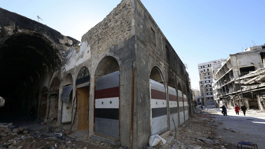 Dec. 9, 2015: Damaged shops are seen with new doors in the old city of Homs, Syria.
