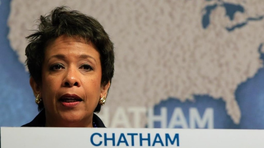 United States Attorney General Loretta Lynch speaking at Chatham House, The Royal Institute for International Affairs, in London, Wednesday, Dec. 9, 2015. (AP Photo/Alastair Grant)