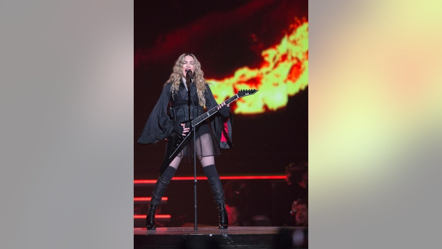 Madonna performs on stage, as part of her Rebel Heart Tour, Wednesday, Dec.  9, 2015, in Paris. (AP Photo/Jacques Brinon)