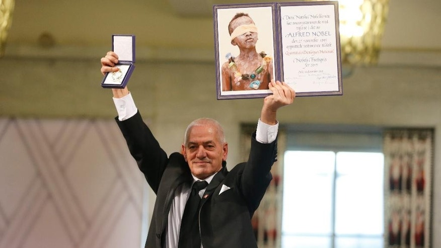 Member of the Tunisian National Dialogue Quartet Houcine Abassi with the diploma and medallion at the Nobel Peace Prize award ceremony in Oslo, Norway, Wednesday Dec. 10. 2015. The Tunisian National Dialogue Quartet was awarded the 2015 Nobel Peace Prize for its decisive contribution to the building of a pluralistic democracy in Tunisia. (Cornelius Poppe / NTB scanpix via AP) NORWAY OUT