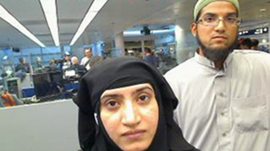 Tashfeen Malik and Syed Farook as they passed through O'Hare International Airport in Chicago in July 2014.