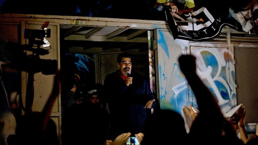 "Venezuela's President Nicolas Maduro speaks to supporters from a truck outside of Miraflores Presidential palace in Caracas, Venezuela, Wednesday, Dec. 9, 2015. Maduro is promising to protect the country's socialist revolution from what he says are ""bad guy"" opposition leaders who will take control of Congress next month.(AP Photo/Fernando Llano)"
