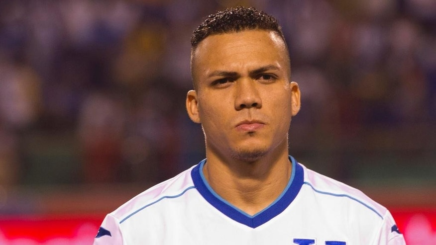 FILE - In this March 5, 2014 file photo, Honduras' soccer player Arnold Peralta prior to a friendly match against Venezuela in San Pedro Sula, Honduras. Peralta's father Carlos confirmed his son was killed on Thursday, Dec. 10, 2015 in his hometown of La Ceiba. Honduran authorities say he was shot dead by an unidentified gunman on a motorcycle in a shopping mall parking lot. (AP Photo/Moises Castillo, File)