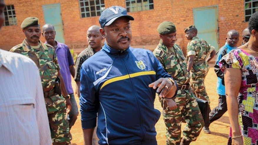 FILE - In this Tuesday, July 21, 2015 file photo, Burundi's President Pierre Nkurunziza walks to a polling station to cast his vote for the presidential election, in his hometown of Ngozi, Burundi. Burundi's military spokesman said Friday, Dec. 11, 2015 that a number of members of a group that attacked three military camps in a bid to steal weapons and free prisoners were killed, with other attackers arrested, as gunfire and explosions rocked the capital, frightening civilians who hid in their homes. (AP Photo/Berthier Mugiraneza, File)