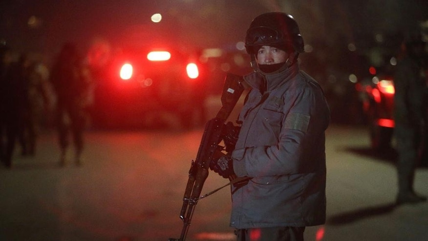A member of Afghan security forces stands guard at the site of a car bomb attack by Taliban militants near a foreign guesthouse in Kabul, Afghanistan, Friday, Dec. 11, 2015. A Taliban spokesman said a suicide bomber targeted the guesthouse in Shir Pur, an area with embassies and other diplomatic buildings that seen to be one of the safer parts of the Afghan capital.(AP Photo/Rahmat Gul)