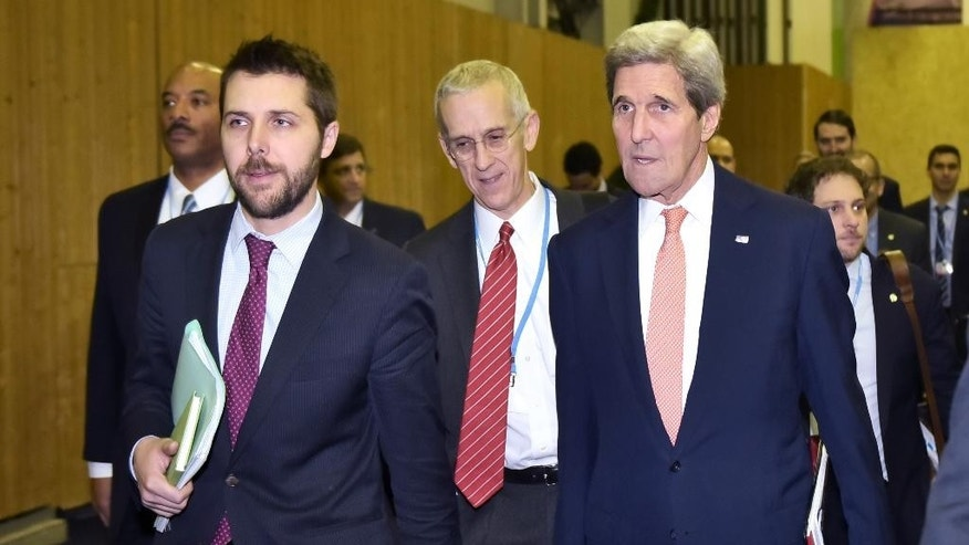 US Secretary of State John Kerry, right, walks with White House senior advisor Brian Deese, left, and US Special Envoy for Climate Change Todd Stern to attend a meeting with French Foreign Minister during the COP21, United Nations conference on climate change in Le Bourget, north of Paris, Thursday, Dec. 10, 2015. (Mandel Ngan, Pool photo via AP)