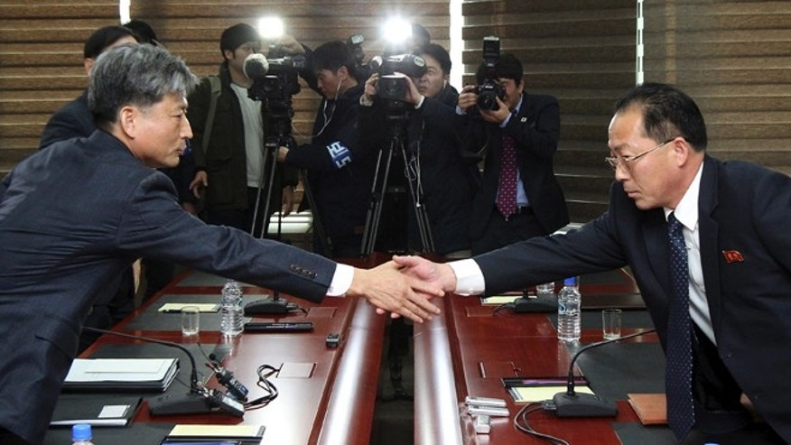 Dec. 11, 2015: Hwang Boogi, left, South Korea' vice minister of unification and the head negotiator for high-level talks with North Korea, shakes hands with his North Korean counterpart Jon Jong Su, right, before their meeting at the Kaesong Industrial Complex in Kaesong, North Korea.