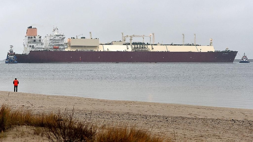 As Poland seeks to diversify its energy sources and cut Russian import gas prices,  the giant LNG ship Al Nuaman, which carries some 200,000 cubic meters of liquefied gas, arrives in the Baltic port of Swinoujscie, Poland, on Friday, Dec. 11, 2015, after 21 days of travel from Qatar. The gas will be used to start operations at the Swinoujscie gas terminal, which should be fully operational in mid-2016 following months of delay. It is the biggest LNG terminal on the Baltic Sea and one of the largest in Europe. (AP Photo/ Lukasz Szelemej)