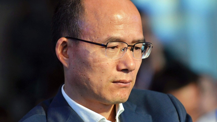 In this June 25, 2015 photo, Guo Guangchang attends the opening ceremony of the new Internet bank MYbank in Hangzhou in east China's Zhejiang province.