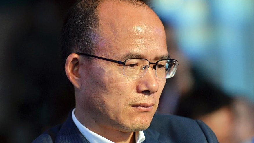 In this June 25, 2015 photo, Guo Guangchang attends the opening ceremony of the new Internet bank MYbank in Hangzhou in east China's Zhejiang province. China's biggest private conglomerate has suspended trading of its shares on Friday, Dec 11, 2015 following a report by a business magazine that its chairman Guo Guangchang, one of the country's most prominent business leaders, is missing.  (Chinatopix Via AP) CHINA OUT