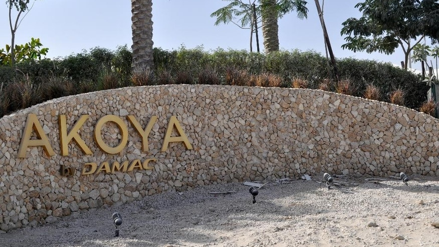 "Pieces of letters that appear to spell out ""Trump"" litter the ground after apparently being removed from a wall at the site of  Damac's Akoya development in Dubai, United Arab Emirates on Friday, Dec. 11, 2015. The image and name of American presidential candidate Donald Trump has been removed from parts of a golf course and housing development in Dubai amid a growing uproar over his comments about banning Muslims from the U.S. (AP Photo/Adam Schreck)"