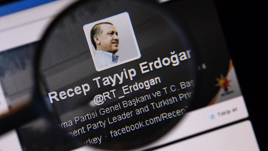 FILE: An image of Turkish Prime Minister Tayyip Erdogan on a Twitter account is pictured through a magnifying glass in this illustration picture.