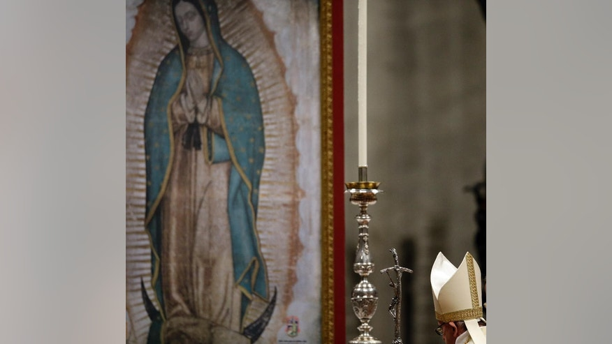 Pope Francis celebrates a mass on the occasion of the Virgin Mary of Guadalupe festivity in St. Peter's Basilica, at the Vatican, Saturday, Dec. 12, 2015. (AP Photo/Gregorio Borgia)
